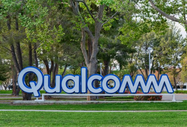 qualcomm logo with background trees