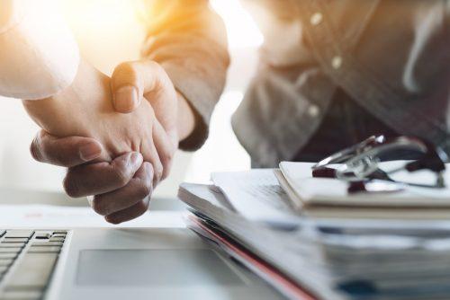 merger shaking hands