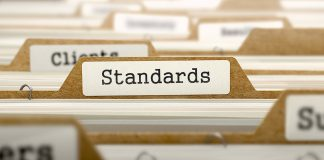 Standards Setting Standards Development and Division of the Gains from Standardization